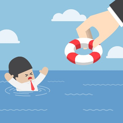 Drowning businessman getting lifebuoy from big hand